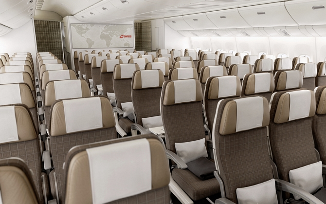 //www.pasazer.com/img/images/normal/swiss,new,cabin,b777300er,media%20(12).jpg